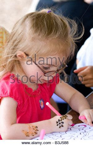 stock photograph of a young girl working in a garden with