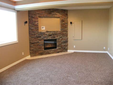 Sumptuous corner gas fireplace vogue omaha traditional basement inspiration with bar basement
