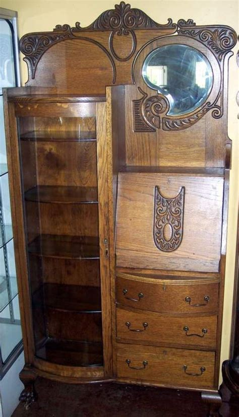 Lot 3210   OAK CURVED FRONT SECRETARY WITH CLAW FEET