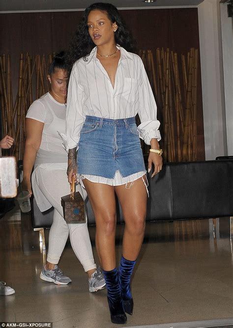 rihanna slips from denim skirt into leopard print trousers