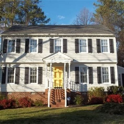 what colors look best on white house navy shutters yellow front door what color