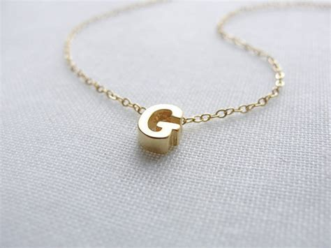 items similar to tiny gold capital letter necklace