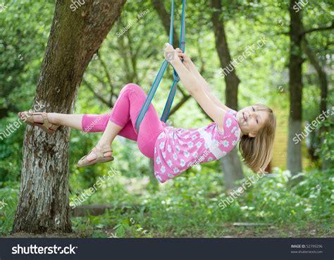 little girl on swing happy little girl swinging park stock photo 52799296