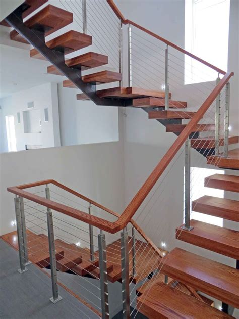 steel banisters modern wood stairs with a stainless steel cable railing