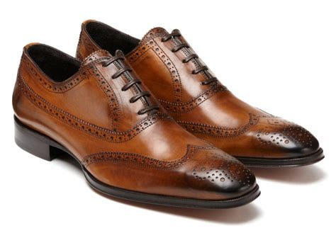 brown dress shoes on