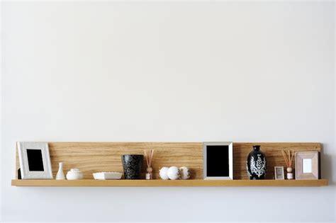 how to hang bookshelves how to hang shelves bob vila