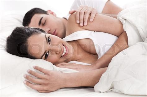 wife in bed loving husband and wife lying in bed over white background