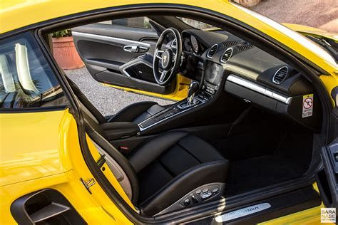 porsche black interior drive porsche 718 cayman racing yellow in south