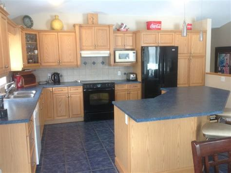 blue floor tile and blond kitchen cabinets work arounds