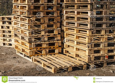 free wood pallets wooden transport pallets in stacks royalty free stock photos image 34906718