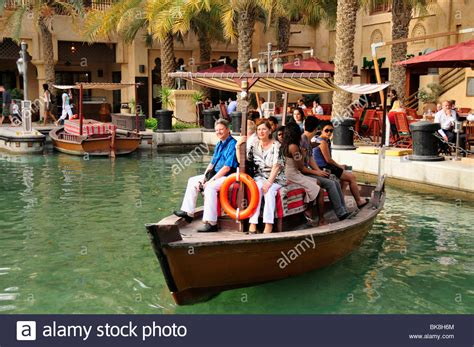 madinat jumeirah boat ride excursion boat with tourists in the madinat jumeirah