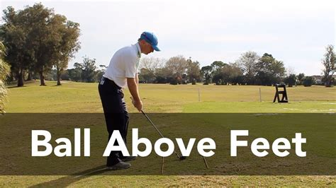 golf swing hitting behind the ball hitting the sidehill lie golf shot with ball above feet