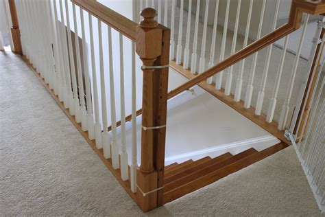 Gate For Stairs With Banister by Installing A Baby Gate Without Drilling Into A Banister