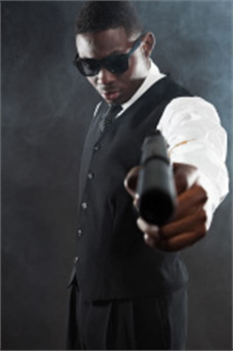 gangster mafia man in suit with tie smoking a stock photos
