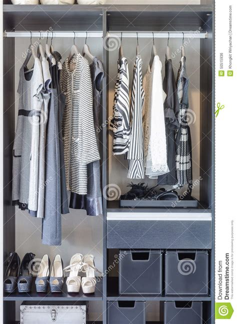 Black Clothes Closet Black And White Clothes In Black Closet Stock Photo
