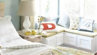 Bedroom corner window seat with cushion