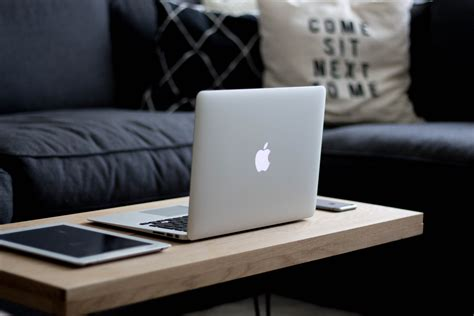 Architecture Desk by Mac Iphone Amp Ipad On Coffee Table Free Stock Photo