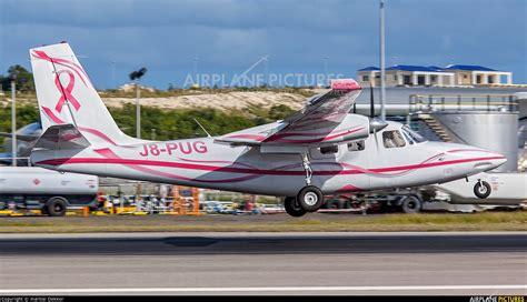 pug airplane j8 pug mustique airways aero commander 500 at sint maarten princess juliana intl