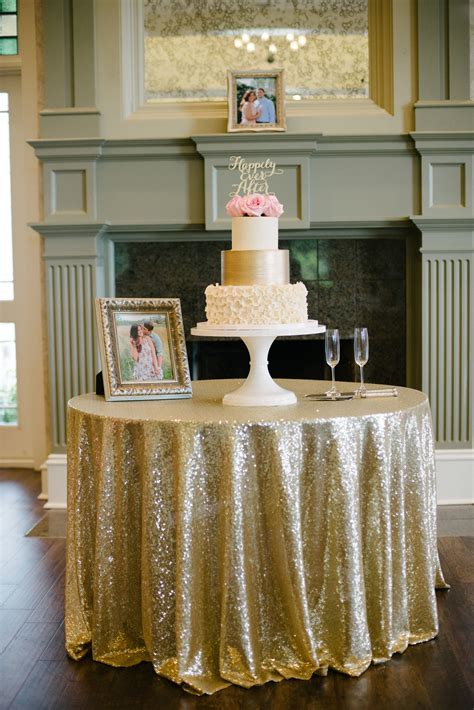 Beautiful Wedding Cake Display On A Sequined Table Cloth