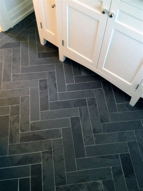 Marble tiles into a brick pattern for a herringbone look could copy with less expensive tiles