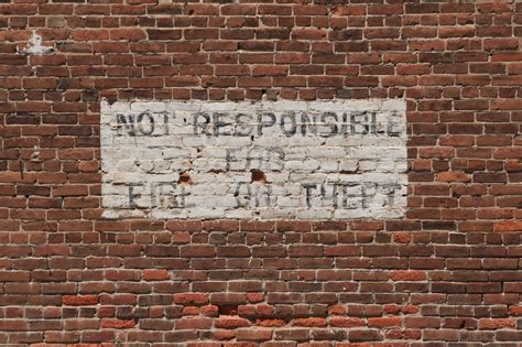 brick wall with painted sign free stock photo domain pictures