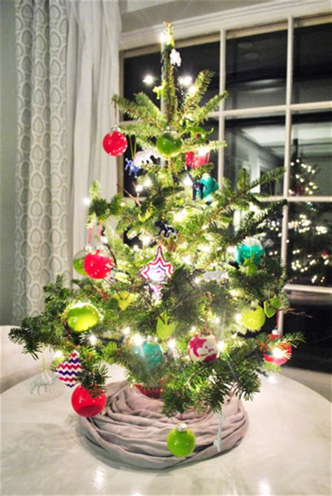 decorating our tabletop tree with handmade ornaments