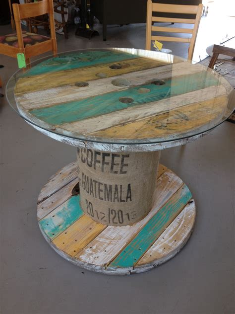 i transformed this spool into a colorful functional table