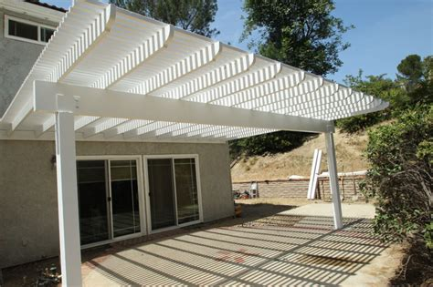 wood lattice patio cover and wood balcony traditional