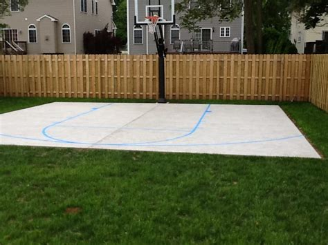 adjacent houses look on s new basketball court