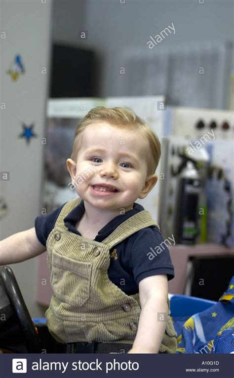 haircuts for one year old boys one year old boy sits in barber stool for first haircut