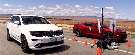 chevrolet jeep 2016 chevrolet camaro ss drag races jeep grand