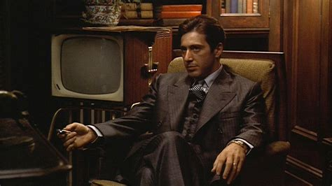 Michael corleone in his preferred pose arms relaxed legs crossed
