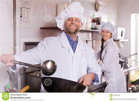 Kitchen Helper In Restaurant Chef And His Helper At Bistro Kitchen Stock Photo Image