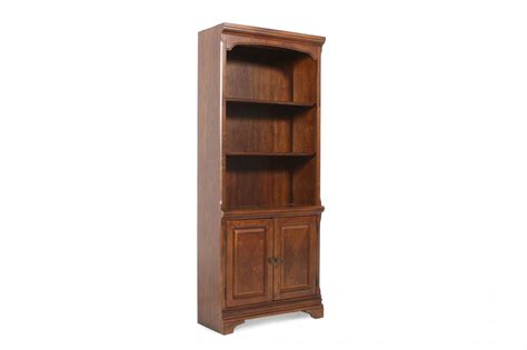 entryway bookcase two door casual bookcase in brown mathis brothers furniture