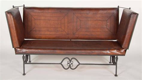 pair of early 20th century leather knole form sofa for