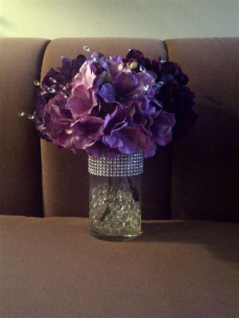 centerpieces   color purple hydrangeas water
