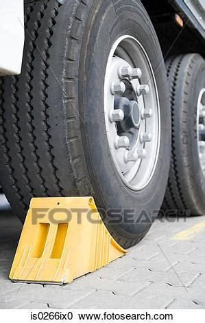 stock photography  chock beneath  truck wheel isix search stock  pictures wall