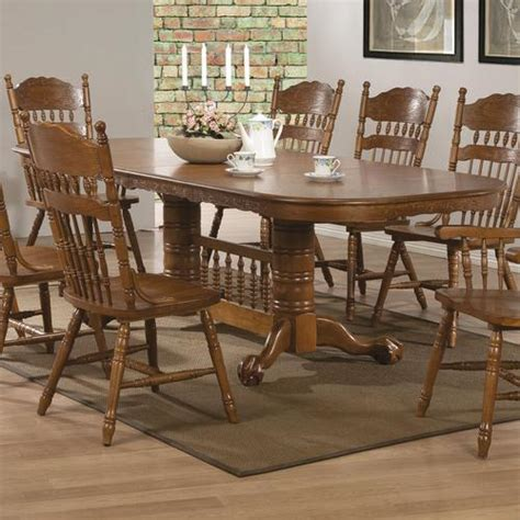 coaster oak finish oval dining table with trestle base