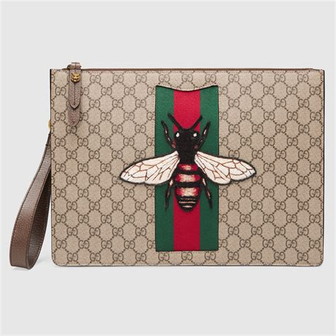 Gucci Amelia Gg Bee Cluth bee embroidery gg supreme clutch bags by gucci buyma
