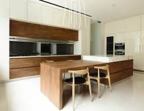 Modern Kitchen Island Table by Nature Inspired Private Residence In Singapore