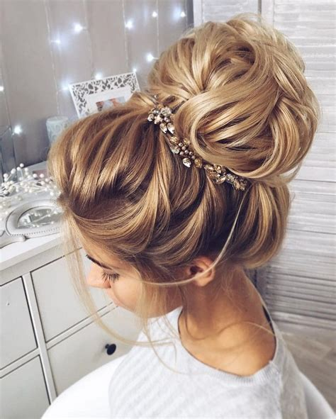 wedding hair up buns this beautiful high bun wedding hairstyle for any