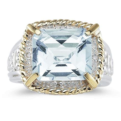 emerald cut aquamarine and ring in 14k yellow gold