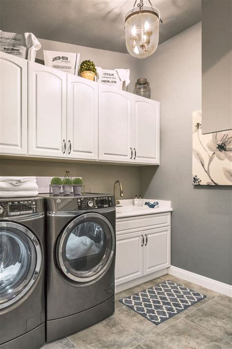 White Laundry Room Cabinets Simple Laundry Room With White Cabinets Grey Washer Dryer And Rustic Lighting Room