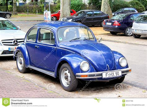 old blue volkswagen vw volkswagen beetle elegant car prked in city editorial