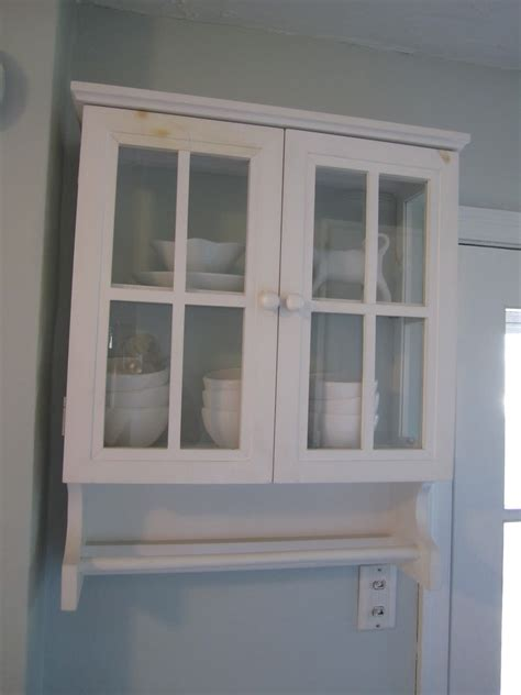 white bathroom wall cabinet with towel bar white wooden wall cabinet with double glass doors and