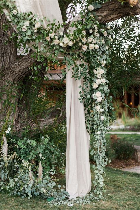 Ceremony site. Flower garland. Tree ceremony. Outdoor