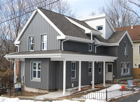 how to paint metal siding on a house the boldness of the metal siding is softened by the muted color choice cottage