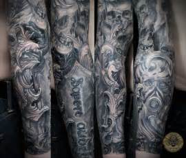 half sleeve viking skull and pirate ship tattoos