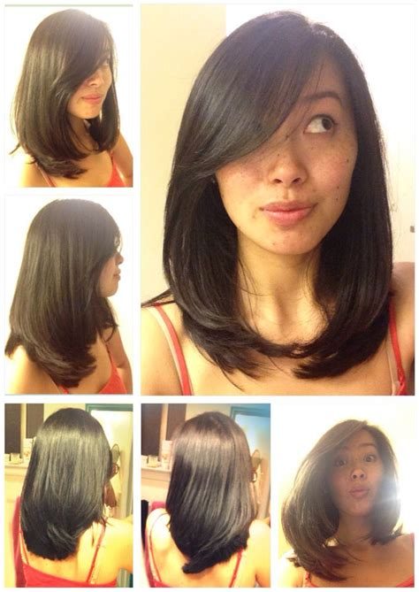 cute haircuts for straight hair with bangs layered straight medium length asian hair side swept bangs