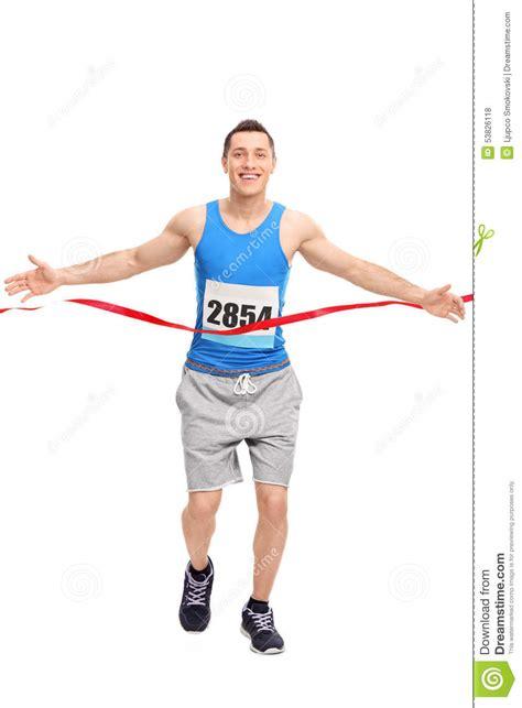 runner line runner crossing the finish line stock photo image 53826118
